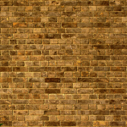 Vieux mur de briques jaunes
