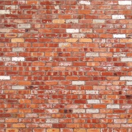 Mur de briques ocre et blanc