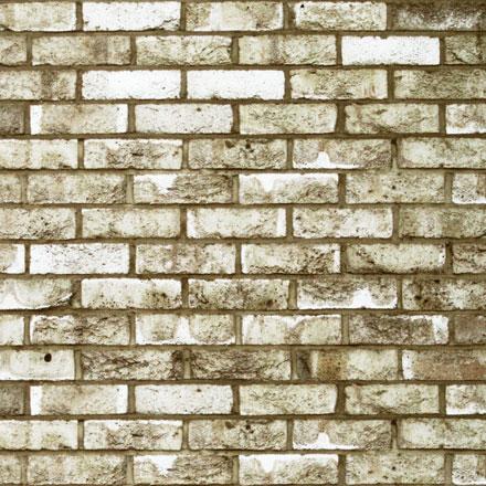 Vieux mur de briques blanches