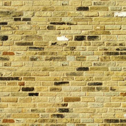 Ancien mur de briques jaunes