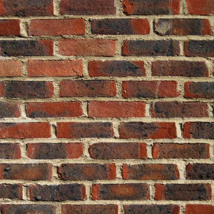 Mur de briques noircies