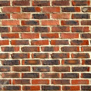 Mur de briques ocre et noir