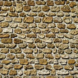 Mur maison en pierre meulière